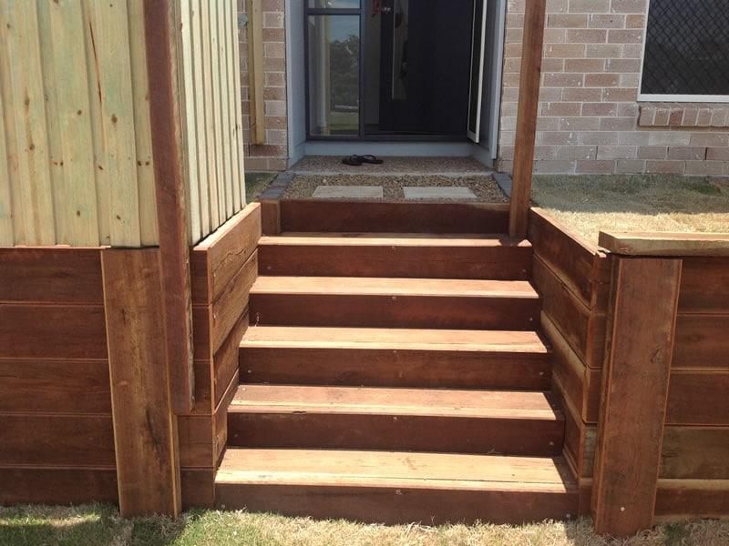 builder outside wooden steps